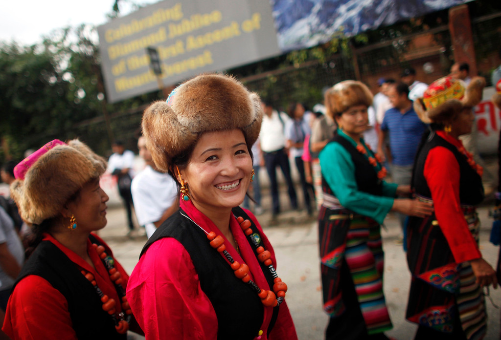 . Nepalese women wearing traditional Sherpa attire participate in a rally to mark  the 60th anniversary of successful ascent of Mount Everest, in Katmandu, Nepal, Wednesday, May 29, 2013. Edmund Hillary and Tenzing Norgay were the first people to set foot on the peak of Mount Everest on May 29, 1953. (AP Photo/Niranjan Shrestha)