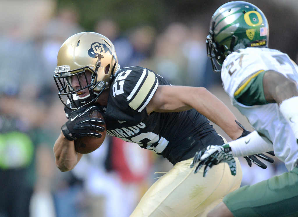 . BOULDER, CO - OCTOBER 05 : WR Nelson Spruce of University of Colorado (22) catches a pass over DB Terrance Mitchell of University of Oregon (27) at Folsom Field. Boulder, Colorado. October 5, 2013. Oregon won 57-16. (Photo by Hyoung Chang/The Denver Post)