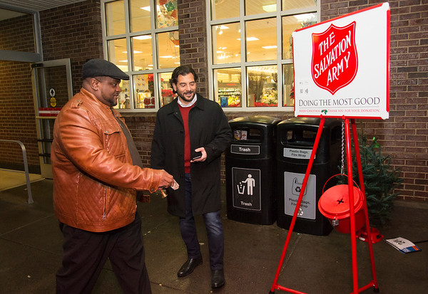 12/09/19 Wesley Bunnell | StaffrrState Senator Gennaro Bizzarro, L, and State Rep. William Petit Jr. , not shown, collected for the Salvation Army outside of the Corbin Ave Stop & Shop on Monday evening.