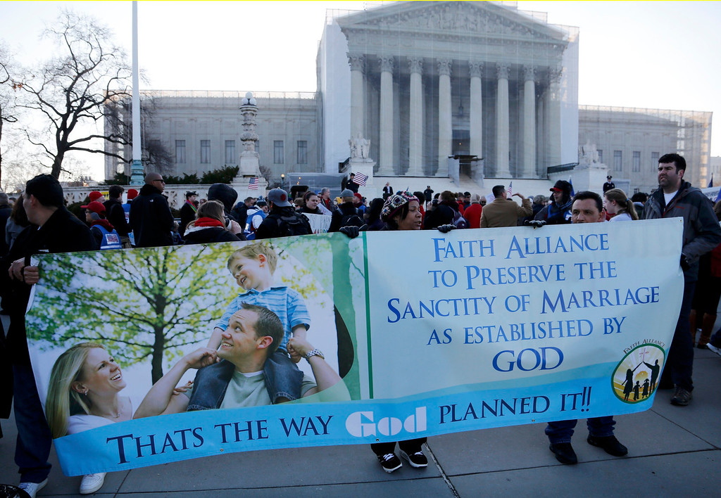 . Protesters in favor of Proposition 8 hold a banner outside of the U.S. Supreme Court in Washington, March 26, 2013. REUTERS/Jonathan Ernst