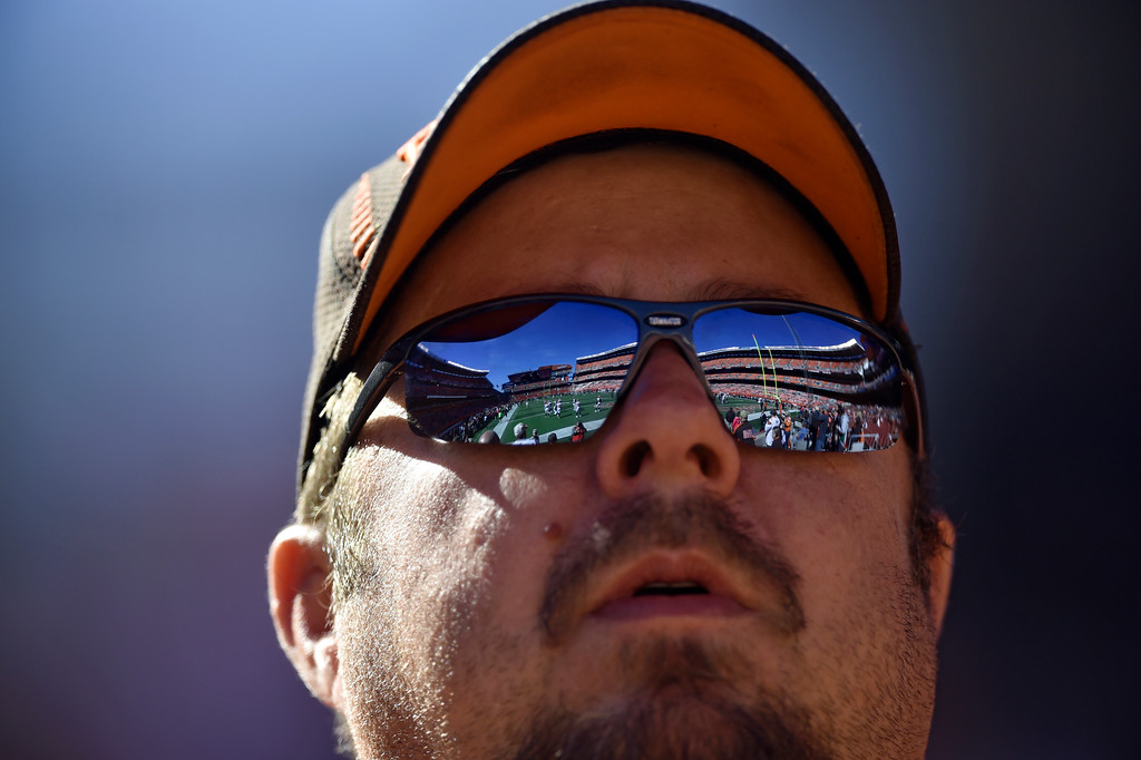 . A Cleveland Browns fan watches the teams warm up before an NFL football game between the Cincinnati Bengals and the Cleveland Browns, Sunday, Oct. 1, 2017, in Cleveland. (AP Photo/David Richard)