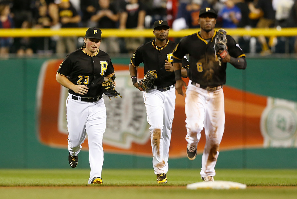 . Pittsburgh Pirates left fielder Travis Snider, left, \\center fielder Starling Marte, center, and right fielder Gregory Polanco run fo meet teammates after defeating the Detroit Tigers inbaseball game on Tuesday, Aug. 12, 2014, in Pittsburgh. (AP Photo/Keith Srakocic)