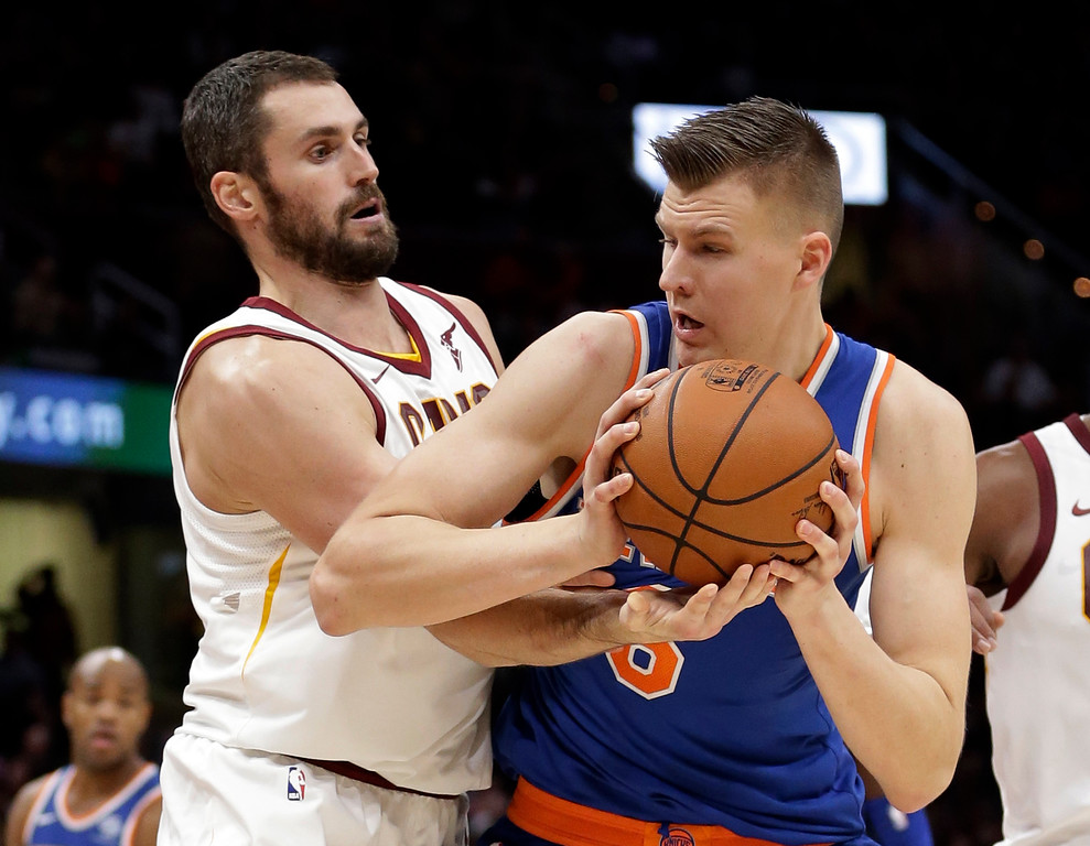. New York Knicks\' Kristaps Porzingis, right, from Latvia, tries to get past Cleveland Cavaliers\' Kevin Love in the second half of an NBA basketball game, Sunday, Oct. 29, 2017, in Cleveland. The Knicks won 114-95. (AP Photo/Tony Dejak)