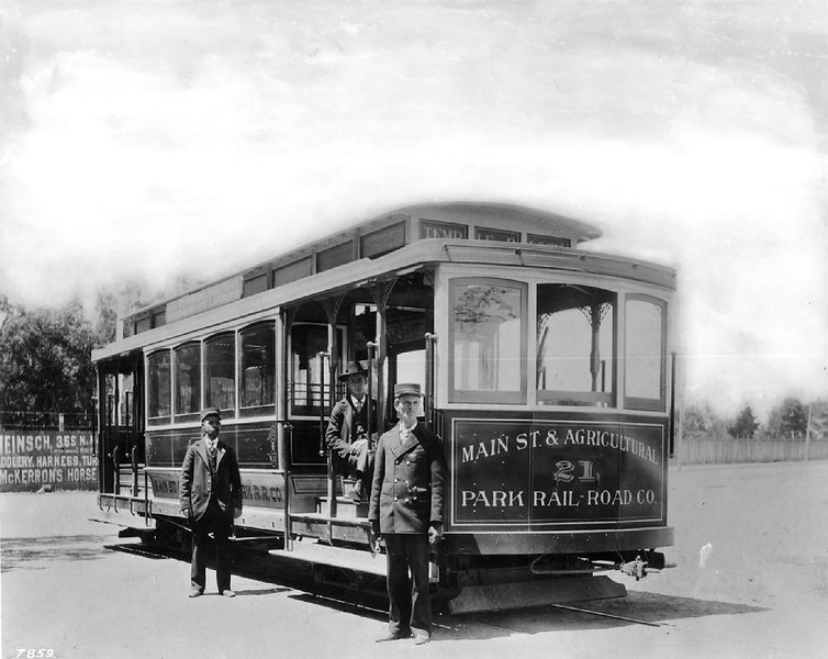 Streetcar with conductors at the Agricultural Park and Main Street terminal of the street railway system, 1897