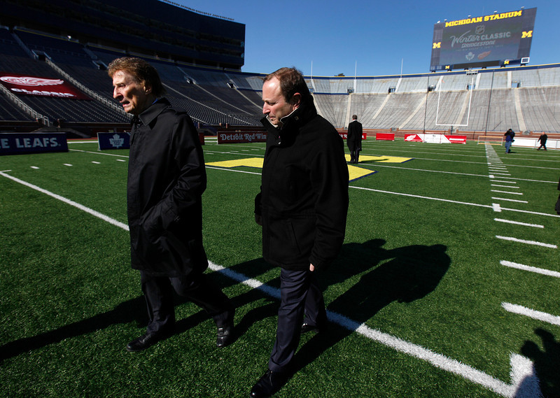 . Detroit Red Wings owner Mike Ilitch, left and National Hockey League commissioner Gary Bettman walk on the field after announcing the NHL Winter Classic hockey game at Michigan Stadium in Ann Arbor, Mich., Thursday, Feb. 9, 2012. The Toronto Maple Leafs will play the Detroit Red Wings at Michigan Stadium on Jan. 1, 2013.  (AP Photo/Paul Sancya)