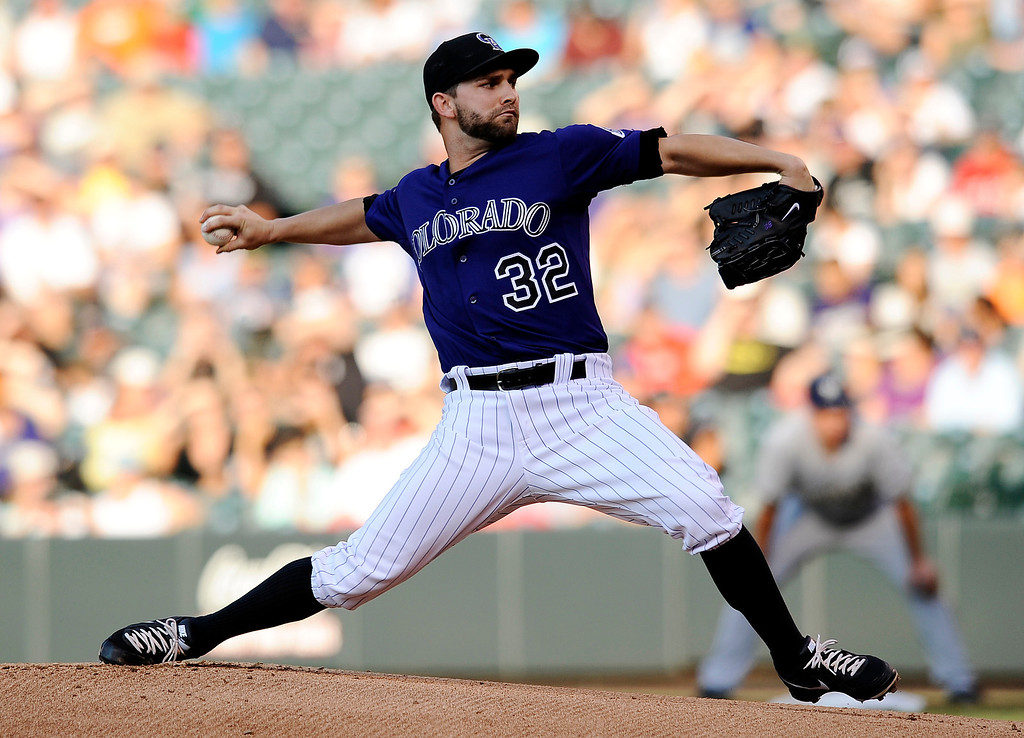 . Colorado Rockies starting pitcher Tyler Chatwood throws in the first inning of a baseball game against the Milwaukee Brewers, Friday, July 26, 2013, in Denver. (AP Photo/Chris Schneider)