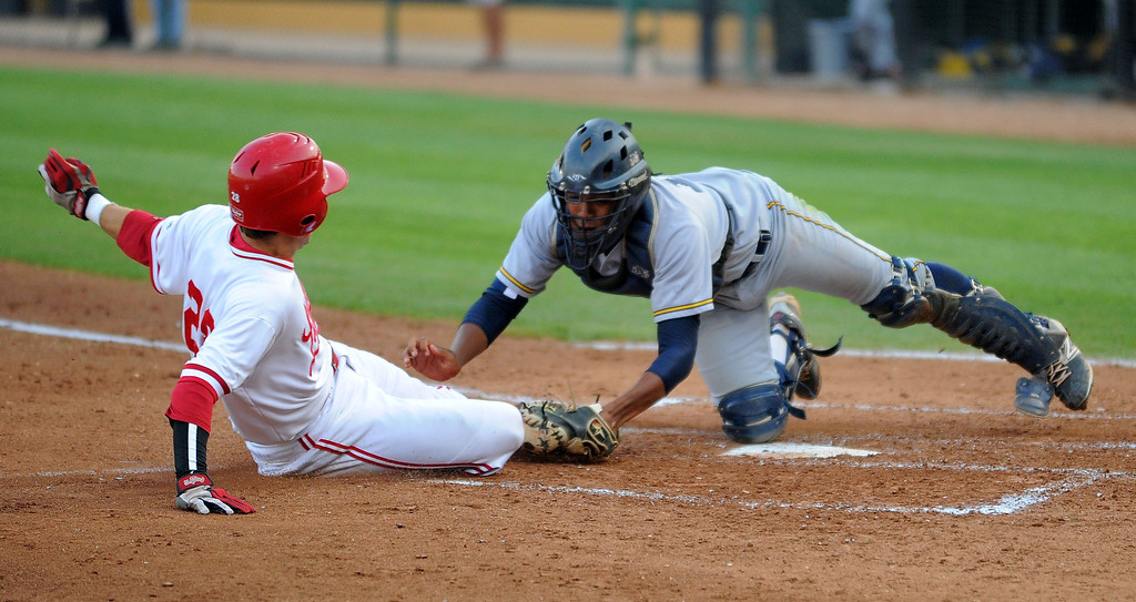 . LONG BEACH - 05/01/13 - (Photo: Scott Varley, Los Angeles Newspaper Group)  Lakewood vs Millikan baseball at Blair Field. Millikan catcher Giovanny Higueros applies the tag on Nick Reeser in the 1st inning for an out at home.