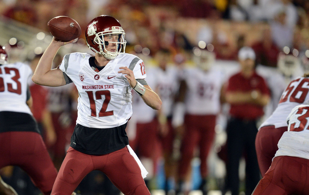 . Washington State\'s Connor Halliday #12 passes during their game against USC at the Los Angeles Memorial Coliseum  Saturday, September 7, 2013. Washington State beat USC10-7. (Photo by Hans Gutknecht/Los Angeles Daily News)