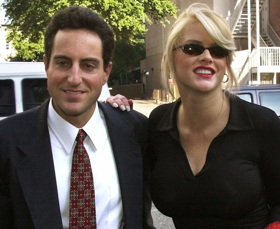 . FILE - In this Oct. 2, 2000 file photo, Anna Nicole Smith, right,  smiles as she walks to the courthouse with her attorney Howard K. Stern in Houston. Attorneys in the Anna Nicole Smith drug conspiracy trial are set with final arguments aimed at swaying jurors in reaching a complicated and crucial set of verdicts that will affect two doctors and the deceased model\'s former boyfriend. (AP Photo/Brett Cooomer, File)
