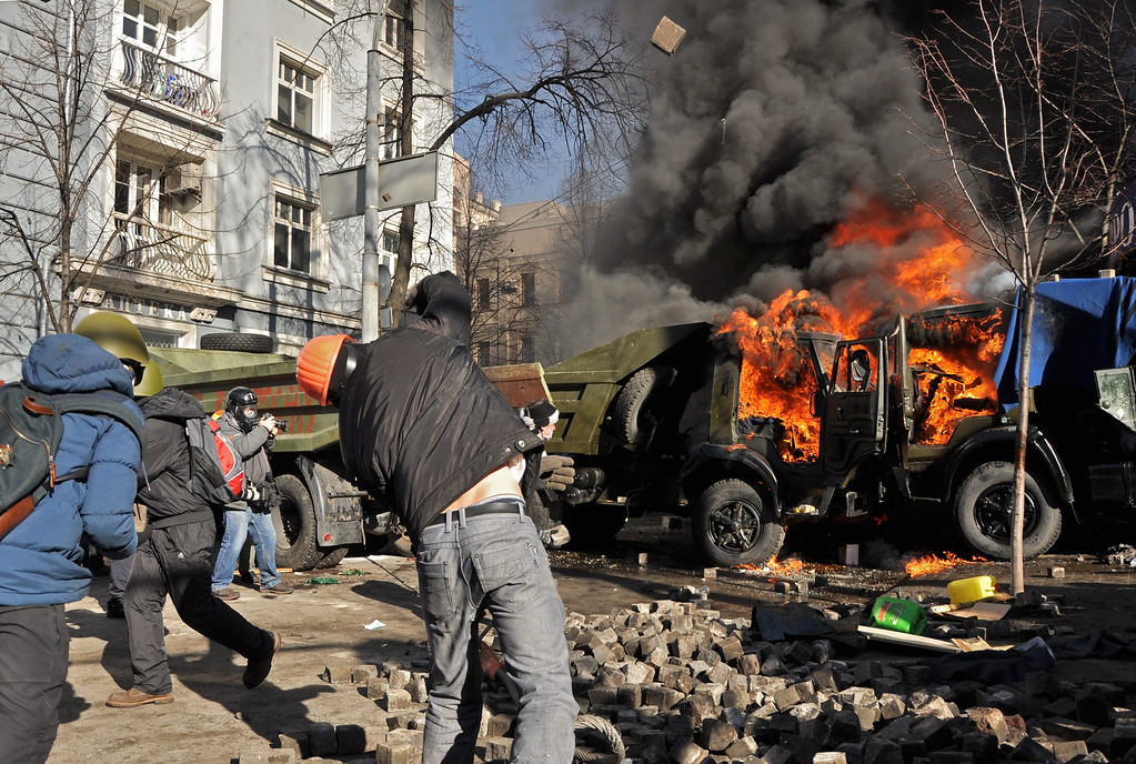 . Protesters clash with riot police during the continuing protest in downtown Kiev, Ukraine, 18 February 2014.  EPA/DANYLO PRYHODKO