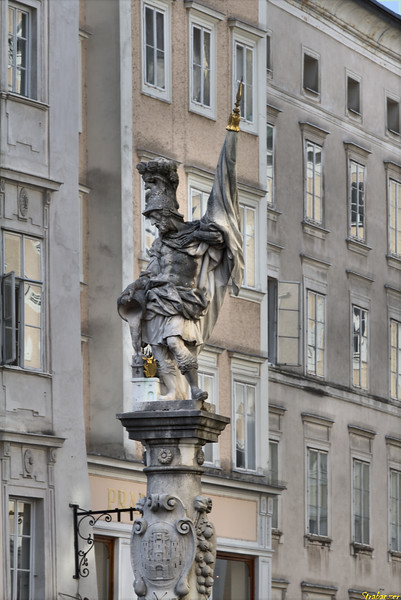 The Florianibrunnen.   The pillar displays the coat of arms of the