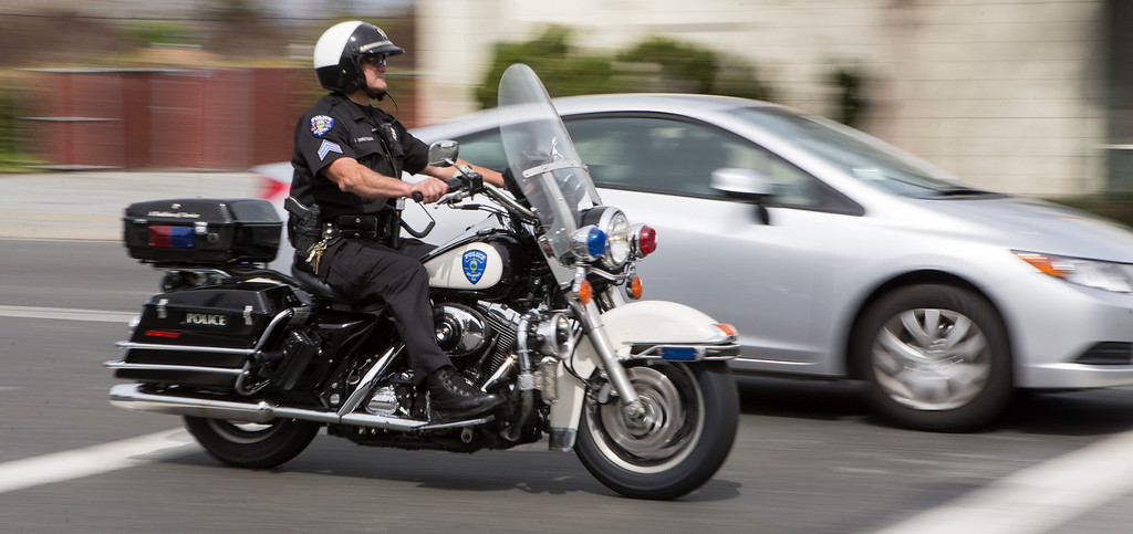 . A Belmont motorcycle officer pulls over a driver not stopping for pedestrians crossing El Camino Real.