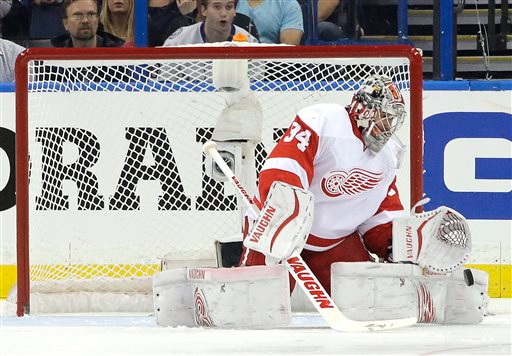 . Detroit Red Wings goalie Petr Mrazek, of the Czech Republic, makes a save on a shot by the Tampa Bay Lightning during the first period of Game 1 of an NHL hockey first-round playoff series Thursday, April 16, 2015, in Tampa, Fla. (AP Photo/Chris O\'Meara)