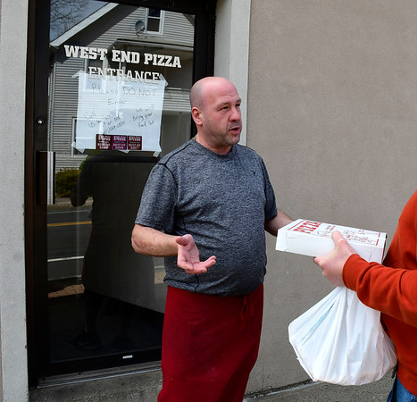 4/2/2020 Mike Orazzi | Staff Steve Guay, co-owner of West End Pizza in Bristol, talks with a customer on Thursday.