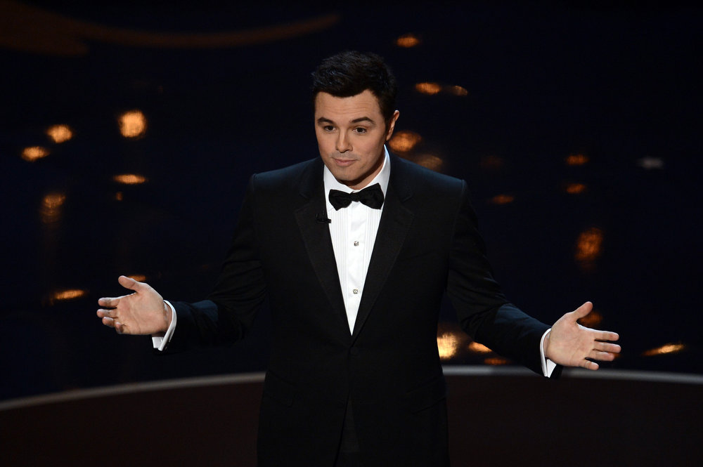 Description of . Host Seth MacFarlane speaks onstage during the Oscars held at the Dolby Theatre on February 24, 2013 in Hollywood, California.  (Photo by Kevin Winter/Getty Images)