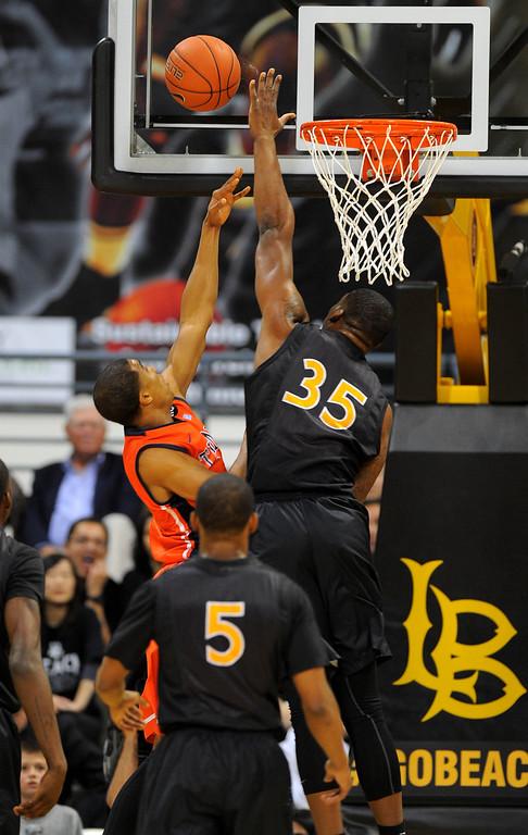 . LONG BEACH - 02/13/13 - (Photo: Scott Varley, Los Angeles Newspaper Group)  LBSU vs Fullerton men\'s basketball. 1st half. LBSU\'s Dan Jennings blocks a  CSUF shot.