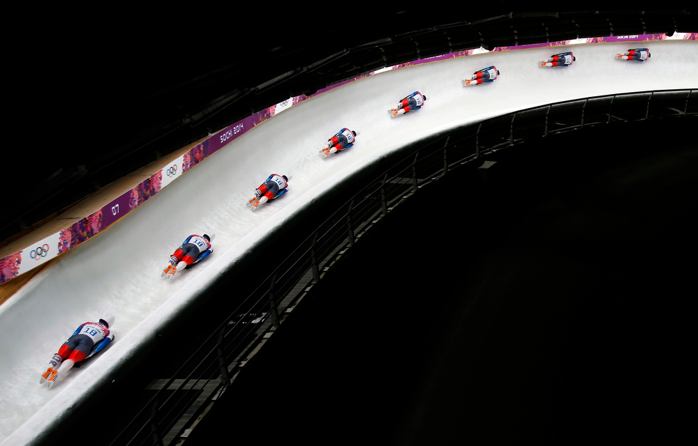 . In this image made with a multiple exposure, Yun Sung-bin of South Korea speeds down the track during the men\'s skeleton final competition at the 2014 Winter Olympics, Saturday, Feb. 15, 2014, in Krasnaya Polyana, Russia.  (AP Photo/Felipe Dana)