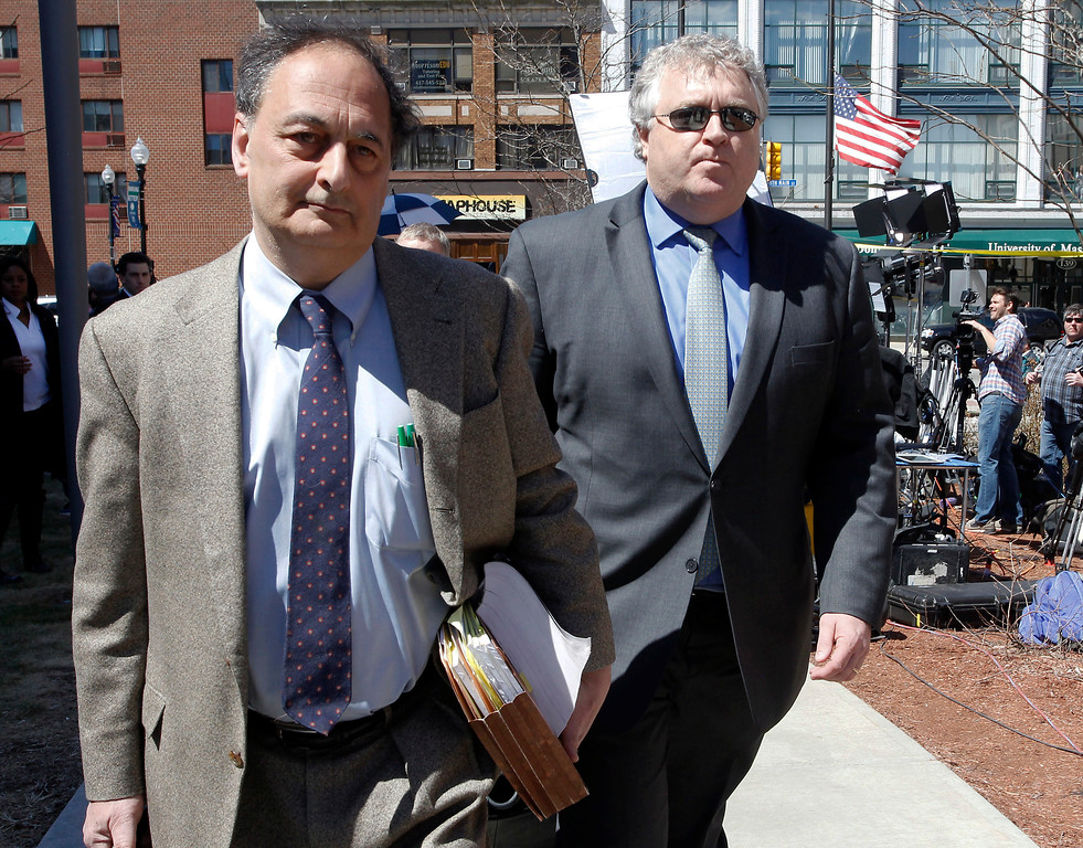 . Defense attorneys James Sultan, left, and Michael Fee, right, leave Bristol County Superior Court, Wednesday, April 15, 2015, in Fall River, Mass., after their client former New England Patriots NFL football player Aaron Hernandez was found guilty of murder in the shooting death of Odin Lloyd. (AP Photo/Stew Milne)