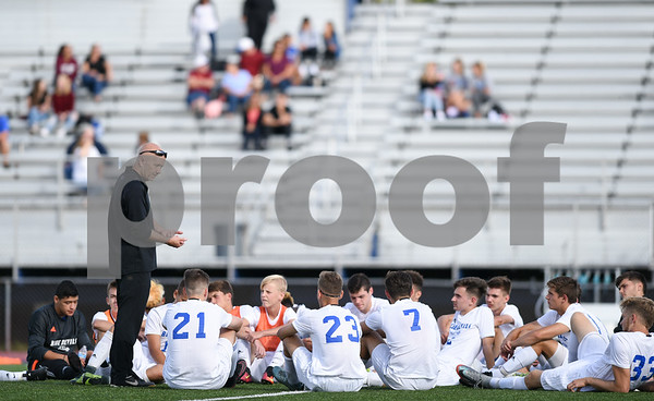 09/08/17 Wesley Bunnell   Staff Plainville Boys Soccer defeated visiting Bristol Eastern on Friday afternoon. A Plainville coach speaks to the team during the half.