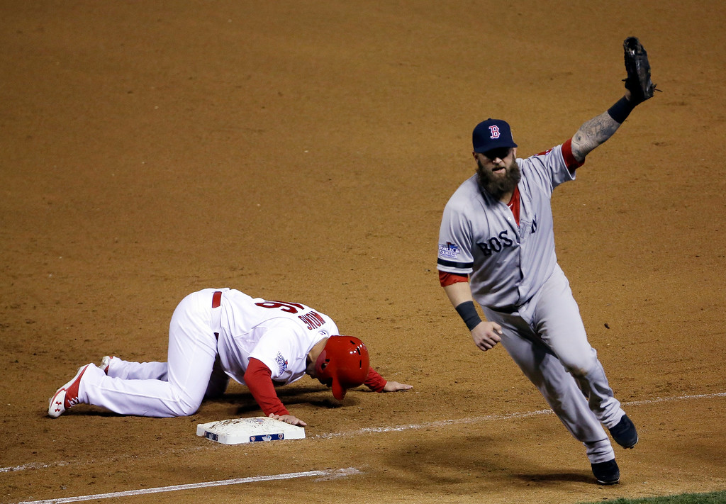 . Boston Red Sox first baseman Mike Napoli celebrates after tagging out St. Louis Cardinals\' Kolten Wong on a pick-off attempt to end Game 4 of baseball\'s World Series Sunday, Oct. 27, 2013, in St. Louis. The Red Sox won 4-2 to ties the series at 2-2. (AP Photo/David J. Phillip)