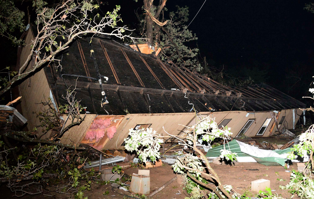 Description of . A damaged mobile home is pictured amid the debris after a tornado swept through Shawnee, in Oklahoma May 19, 2013. A massive storm front swept north through the central United States on Sunday, hammering the region with fist-sized hail, blinding rain and tornadoes, including a half-mile wide twister that struck near Oklahoma City. News reports said at least one person had died. REUTERS/Gene Blevins
