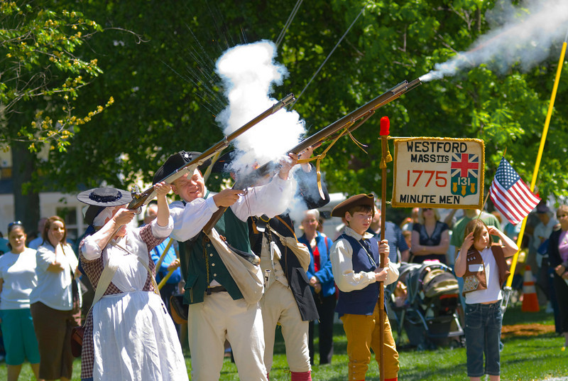 Twenty-one Musket Salute - Men and women reenact a revolution-era twenty-one gun salute.
