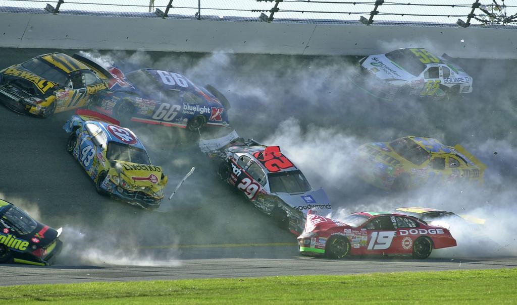 . Nine of the 17 cars involved in the Daytona 500 crash in turn 2 slide around the track at Daytona International Speedway in Daytona Beach, Fla., Sunday, Feb. 17, 2002.  Shown are Matt Kenseth (17), Todd Bodine (66), John Andretti (43), Kevin Harvick (29), Jeremy Mayfield (19), Kenny Schrader (36), Bobby Hamilton (55) and Kenny Wallace (1), bottom right. (AP Photo/Phil Manson)