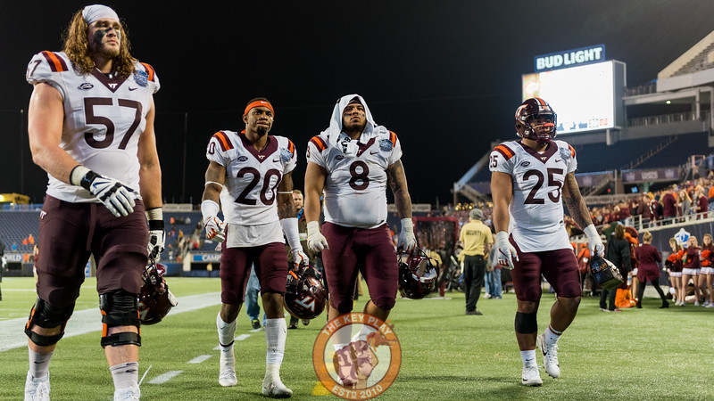 Wyatt Teller (57), Deon Newsome (20), Ricky Walker (8) and Andrew Motuapuaka (25) walk off the field after the Camping World Bowl between Virginia Tech and Oklahoma State in Orlando, Fl., Thursday, Dec. 28, 2017. (Special by Cory Hancock) Teller, Newsome and Motuapuaka all played in their game as Hokies.