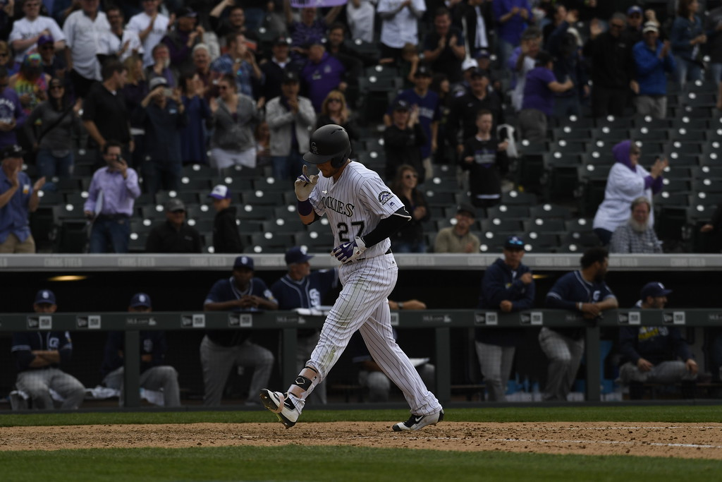 . DENVER, CO. - APRIL 08: Trevor Story (27) of the Colorado Rockies comes home after hitting a solo home run in the ninth inning. The Colorado Rockies played the San Diego Padres Friday, April 8, 2016 on opening day at Coors Field in Denver, Colorado. (Photo By Andy Cross/The Denver Post)