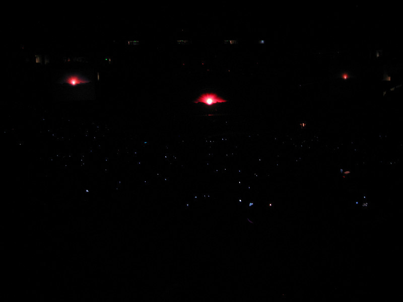 "All those little lights are peoples cameras recording the opening. So much for lighters these days. Cameras or cell phones are the new ""in"" thing (lame)."