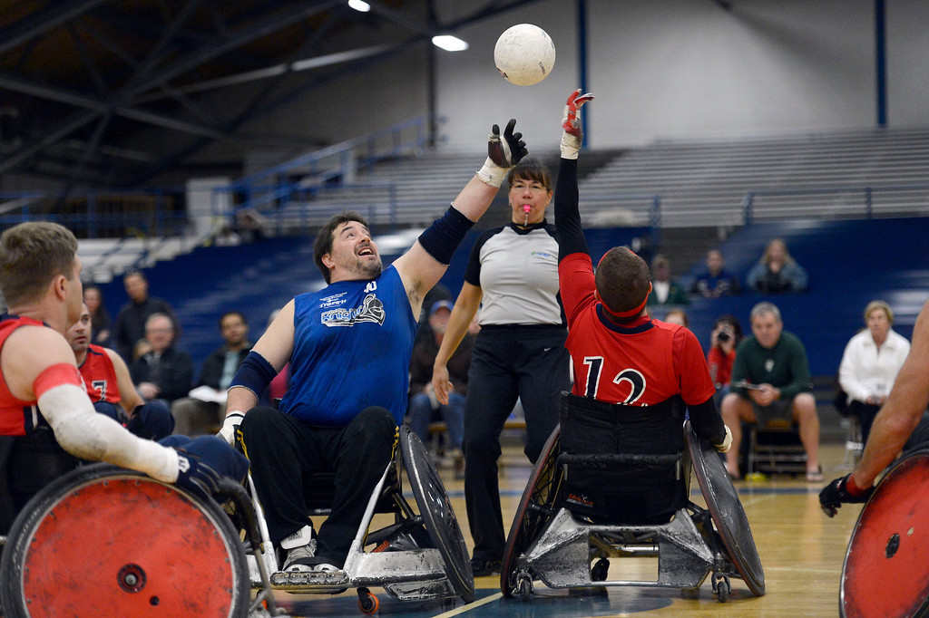 . DENVER, CO. - FEBRUARY 10: Martin Flores (10) of the Northridge Knights and Matt Gypin (12) of the Denver Harlequins tip off during the Wheelchair Rugby Tournament February 10, 2013 at Englewood High School.  The Mile High Mayhem was put on by Craig Hospital and city of Englewood.(Photo By John Leyba/The Denver Post)