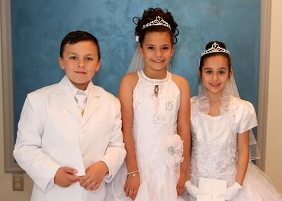 Eliyanna, Quiana, and Larry IV First Communion