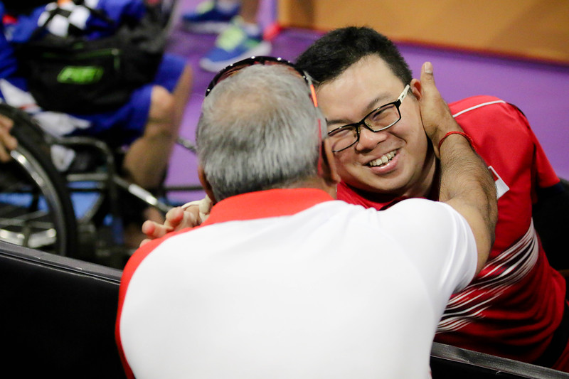 PARA TABLE TENNIS -  CHEE WENG FAI JASON  in ecstatic mood and hugging his support staffs after winning in Men Individual Class 2 Round-Robin at MITEC Hall 7, KL on September 22th, 2017 (Photo by Sanketa Anand)