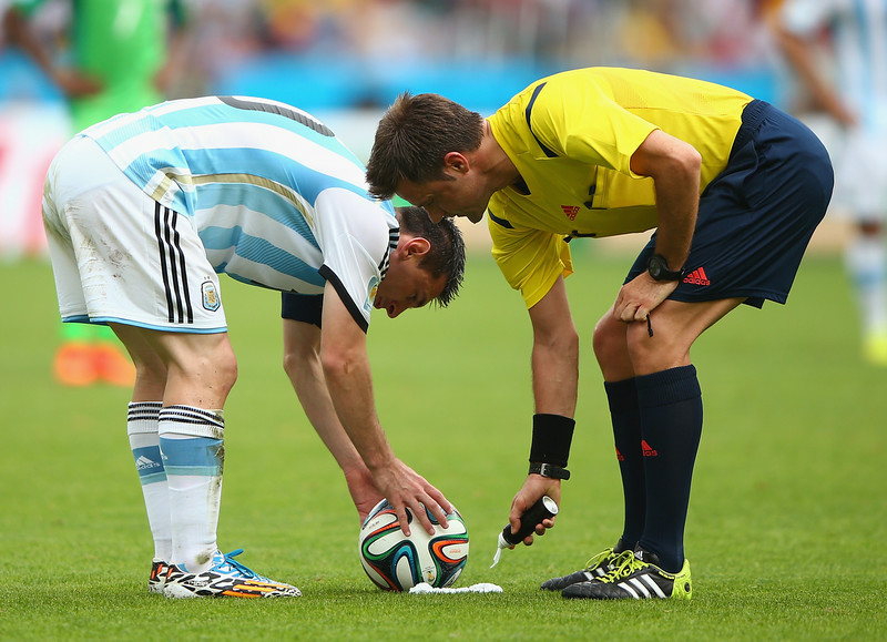 . Lionel Messi of Argentina prepares to take a free kick as referee Nicola Rizzoli sprays a temporary line during the 2014 FIFA World Cup Brazil Group F match between Nigeria and Argentina at Estadio Beira-Rio on June 25, 2014 in Porto Alegre, Brazil.  (Photo by Ian Walton/Getty Images)