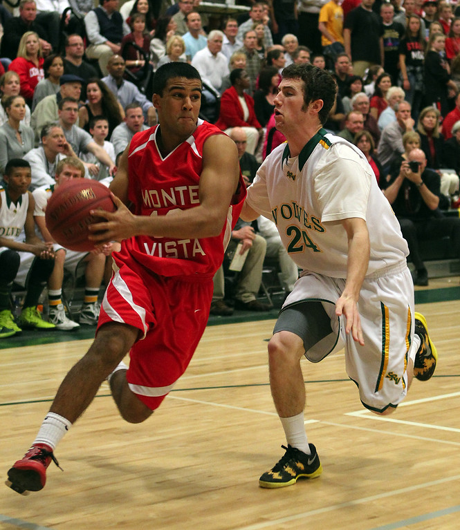 . Monte Vista\'s Rishi Satoor (12) dribbles against San Ramon Valley\'s Andrew Gubera (24) in the first half of their varsity boys basketball game in Danville, Calif., on Friday, Feb. 15, 2013. (Anda Chu/Staff)