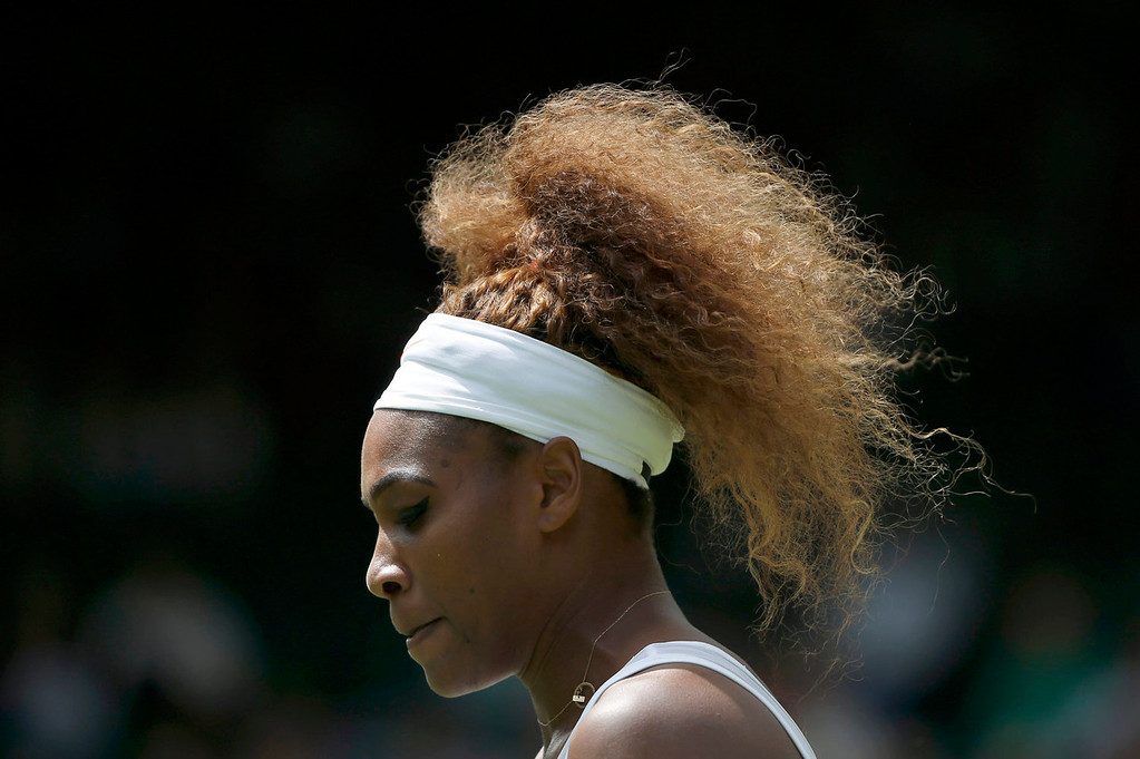 . Serena Williams of the U.S. prepares to serve in her women\'s singles tennis match against Mandy Minella of Luxembourg at the Wimbledon Tennis Championships, in London June 25, 2013.   REUTERS/Eddie Keogh