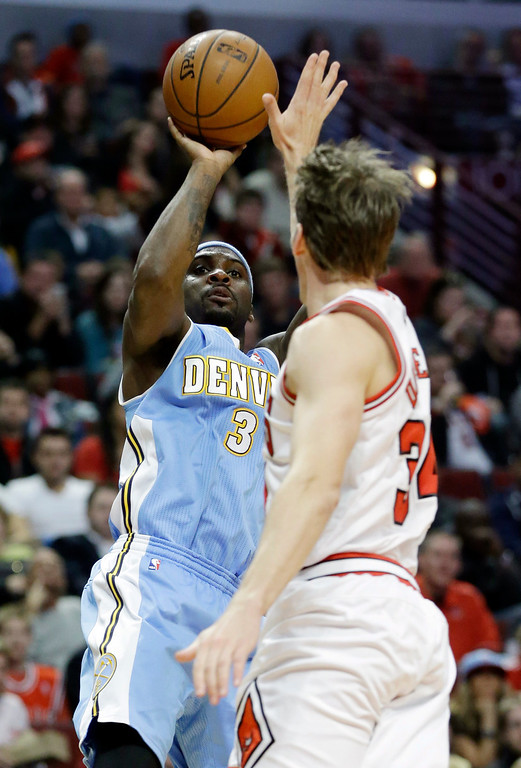 . Denver Nuggets guard Ty Lawson (3) shoots over Chicago Bulls guard Mike Dunleavy during the first half of an NBA preseason basketball game in Chicago on Friday, Oct. 25, 2013. (AP Photo/Nam Y. Huh)