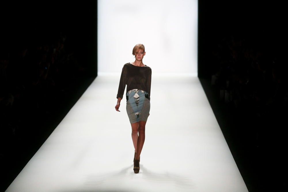 . A model presents a creation of fashion label Barre Noire\'s, Autumn Winter 2014 collection during the Mercedes Benz Fashion Week in Berlin, Wednesday, Jan. 15, 2014. (AP Photo/Markus Schreiber)
