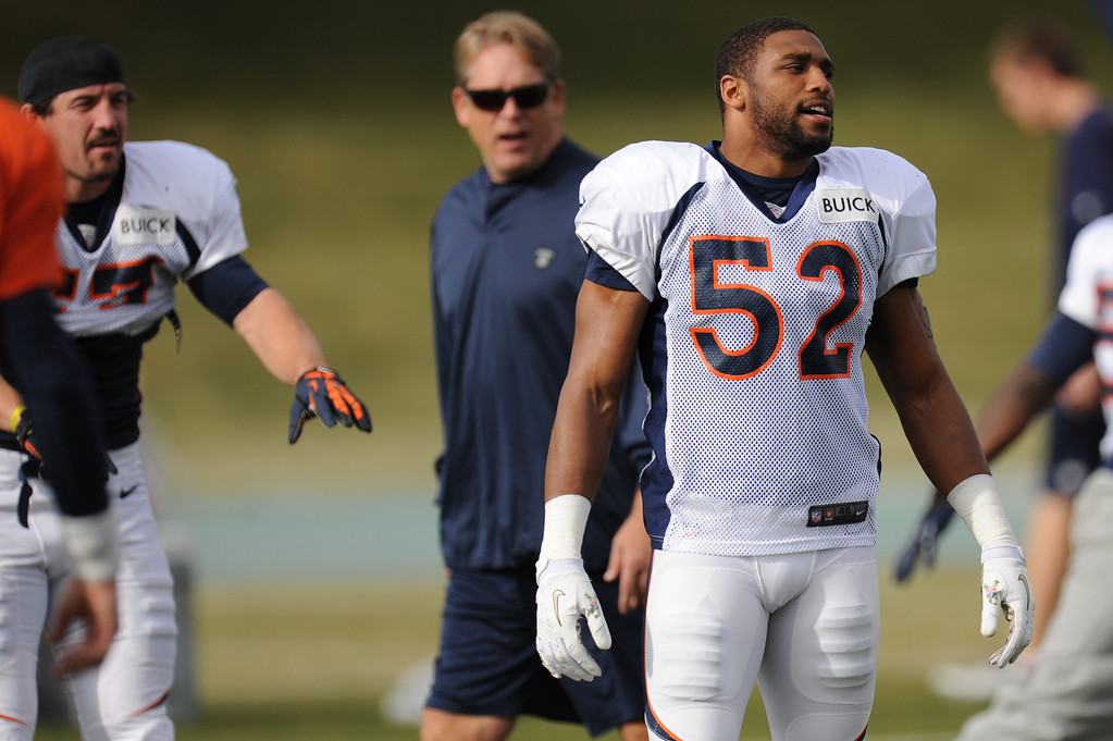 . Denver Broncos outside linebacker Wesley Woodyard #52 stretching during Broncos practice for their coming game against the Tampa Bay Buccaneers at Dove Valley in Denver Colorado Wednesday, November 28,  2012.    Joe Amon, The Denver Post