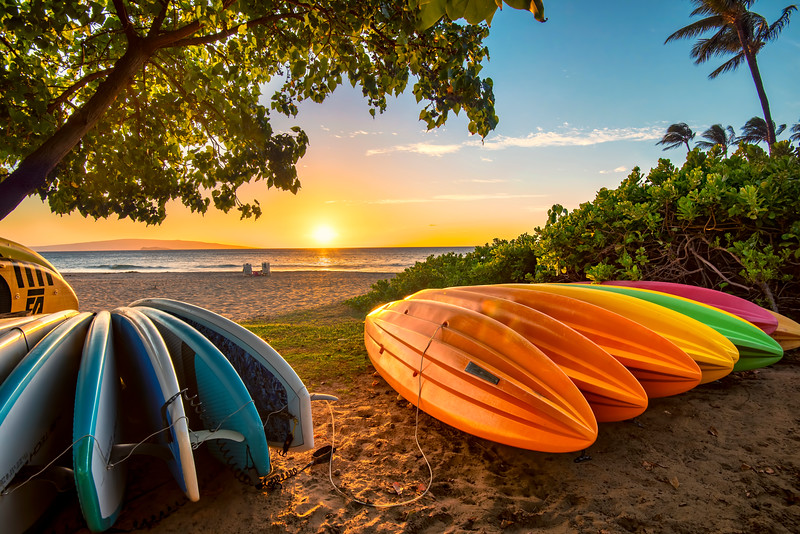 Kayaks in South Maui beach at sunset, Maui, Hawaii