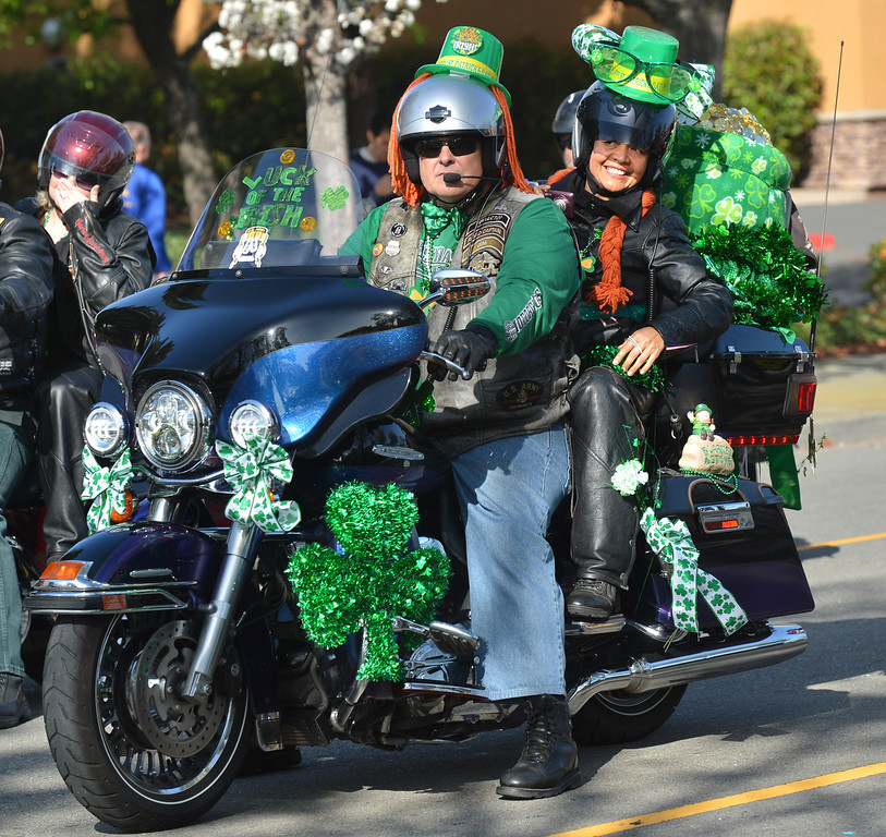 . Jim Bell, left, and Cecile Schelling, right,  both of Oakland, ride with the Oakland Hogs during the Saint Patrick\'s Day Parade in Dublin, Calif., on Saturday, March 16, 2013. (Dan Rosenstrauch/Staff)
