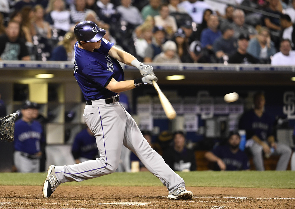 . SAN DIEGO, CA - SEPTEMBER 22:  DJ LeMahieu #9 of the Colorado Rockies hits a single during the fifth inning of a baseball game against the San Diego Padres at Petco Park September, 22, 2014 in San Diego, California.  (Photo by Denis Poroy/Getty Images)