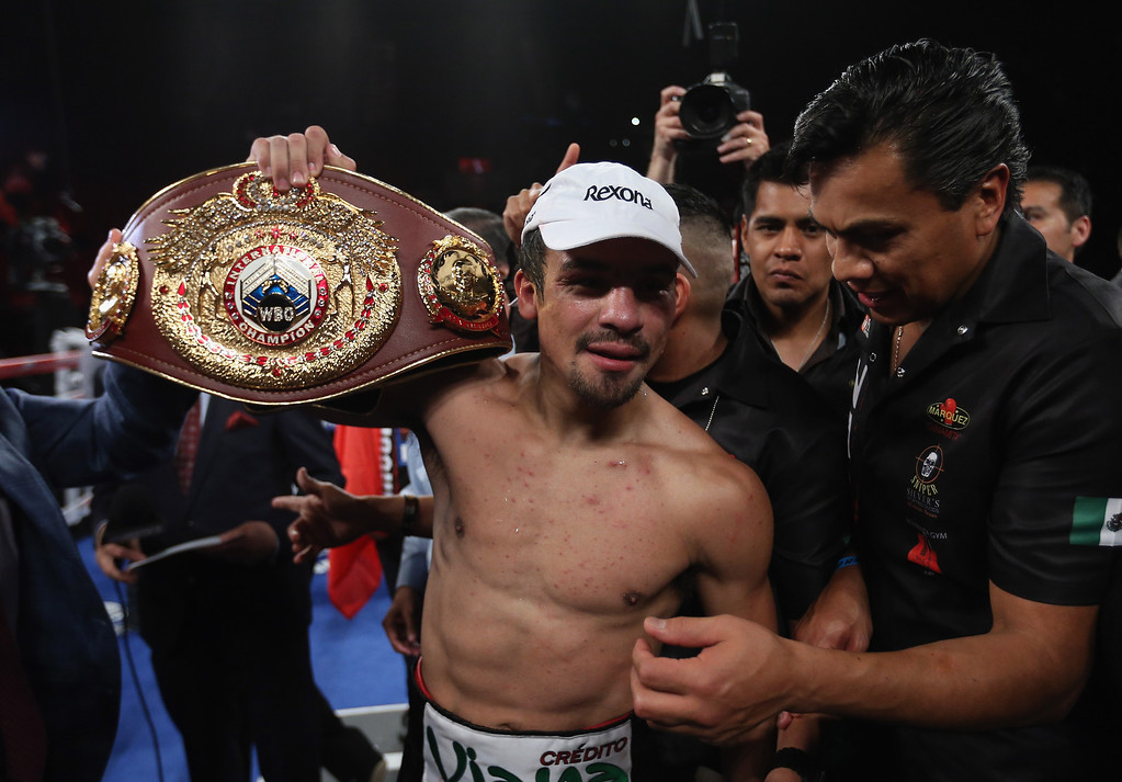 . INGLEWOOD, CA - MAY 17:  Juan Manuel Marquez celebrates his victory over Mike Alvarado at The Forum on May 17, 2014 in Inglewood, California.  (Photo by Jeff Gross/Getty Images)