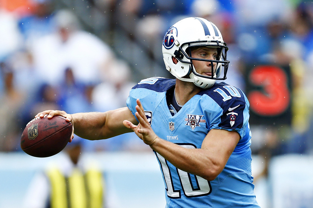 . NASHVILLE, TN - SEPTEMBER 29:  Jake Locker #10 of the Tennessee Titans throws a pass against the New York Jets at LP Field on September 29, 2013 in Nashville, Tennessee.  (Photo by Wesley Hitt/Getty Images)
