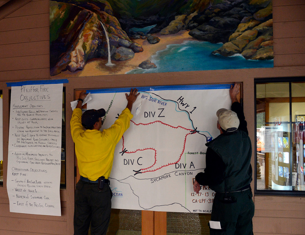 . Firefighters put up a map of the fire before a press conference in Big Sur, Calif. on Tuesday December 17, 2013. (Photo David Royal/ Monterey County Herald)