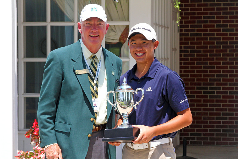 WGA Chairman Jim Bunch poses with champion Collin Morikawa after giving him his trophy.