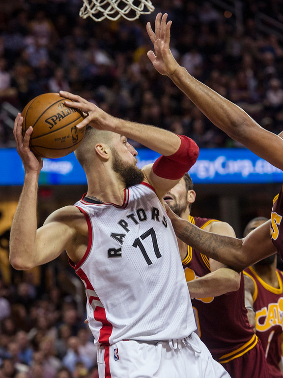 . Toronto Raptors\' Jonas Valanciunas (17) looks to pass against the Cleveland Cavaliers during the second half of an NBA basketball game in Cleveland, Tuesday, Nov. 15, 2016. The Cavaliers won 121-117. (AP Photo/Phil Long)