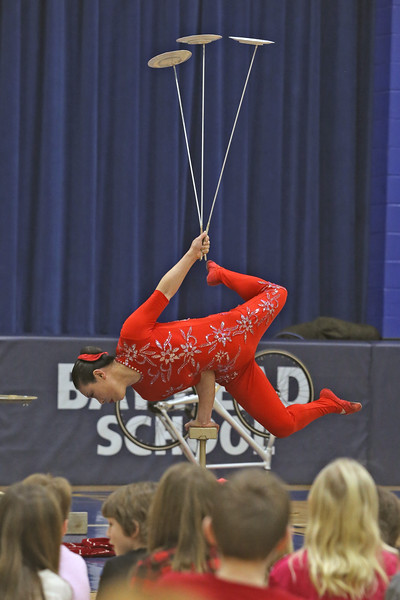 Acrobat Li Liu performs plate spinning during her show for students at the Bay Head Elementary School in Bay Head on Friday Feb. 1, 2019.  (MARK R. SULLIVAN/THE OCEAN STAR)