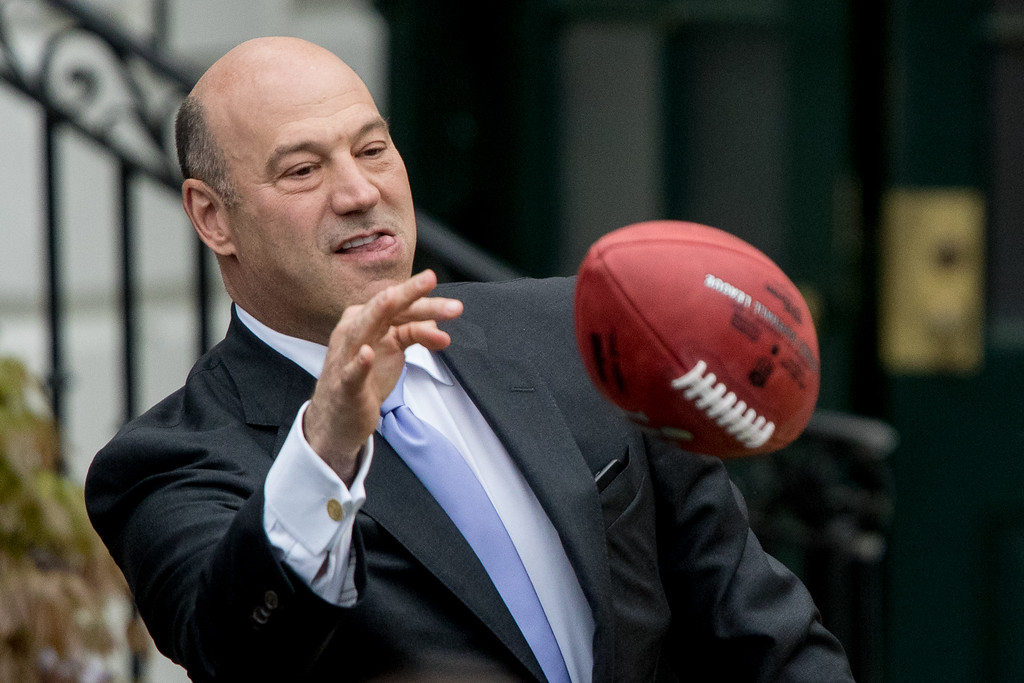 . National Economic Council chairman Gary Cohn tosses a football to a member of the audience following a ceremony on the South Lawn of the White House in Washington, Wednesday, April 19, 2017, where the president honored the Super Bowl Champion New England Patriots for their Super Bowl LI victory. (AP Photo/Andrew Harnik)