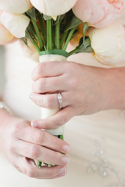 holding bouquet, engagement ring